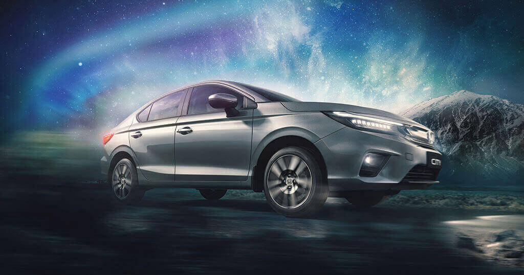 All New 5th Generation Honda City 2020 on road with Bright Stars in Sky in Mountain Region