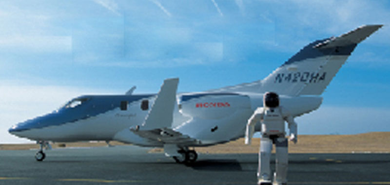 Front View of Asimo Robot Standing with Hondajet