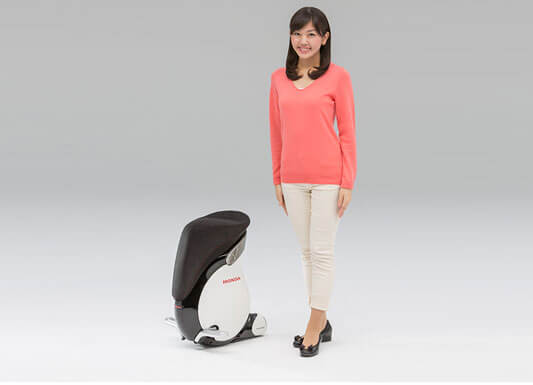 Girl Standing with Small Unicub
